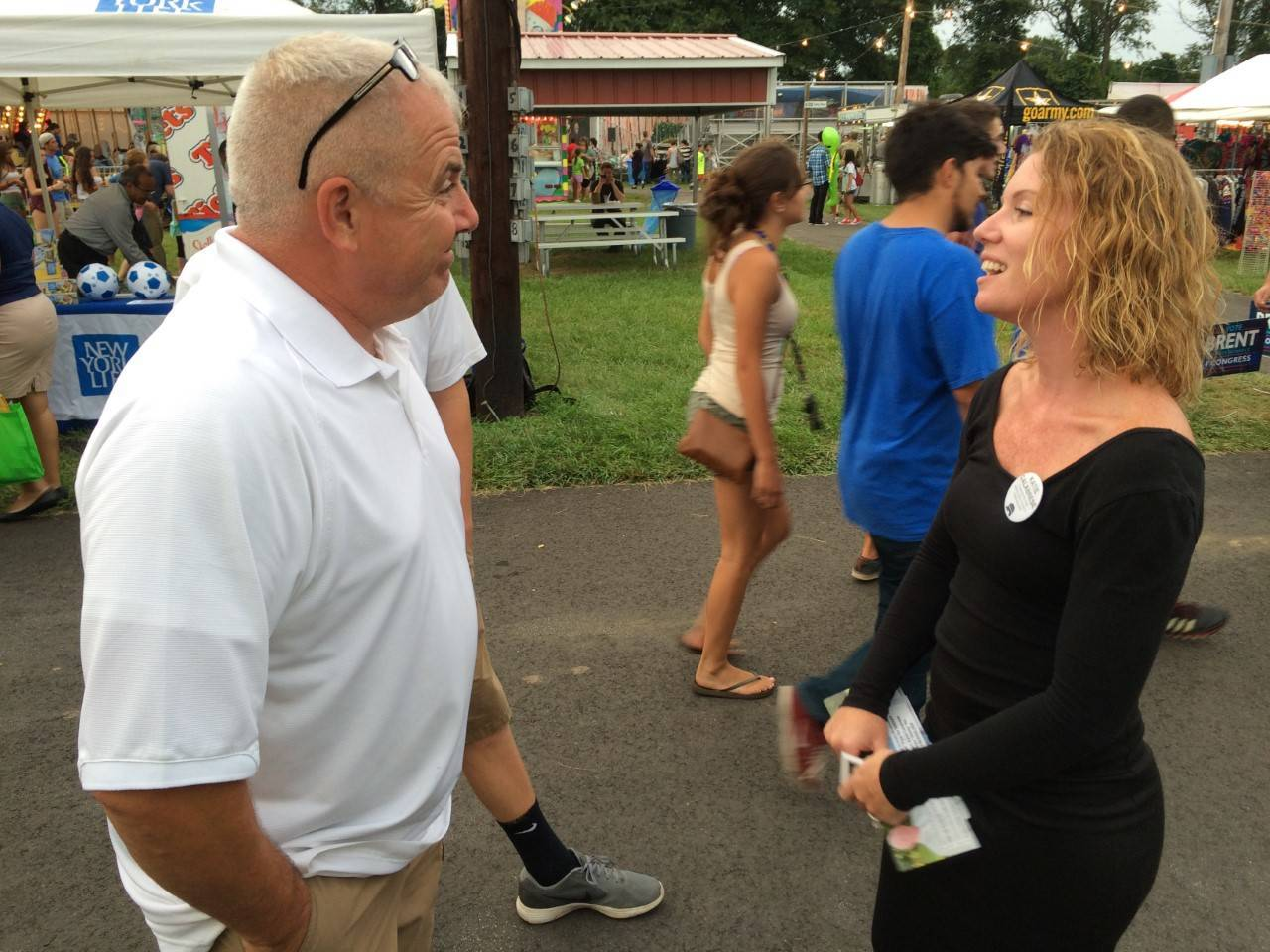 7b24e15d8998e8bc278d_Katie_talking_with_voter.jpg