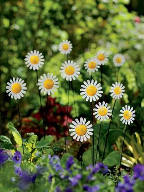 Metal flower sculptures like daisy bouquet stakes can instantly add interest and color to the garden.