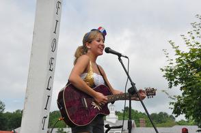 Mary Adams sings from the Elks float.