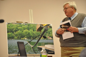 Dave Simmons presents options to remedy the transmission line leak at Fox Hollow Lake.