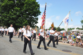Members of the Sparta Volunteer First Aid Squad march down Mohawk Avenue.