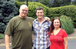 Nicholas Mayse (center) with parents, Eric Mayse and Corinna Morton-Mayse