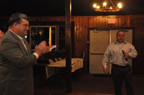 Senator Steve Oroho applauds as Sheriff Mike Strada takes the microphone.