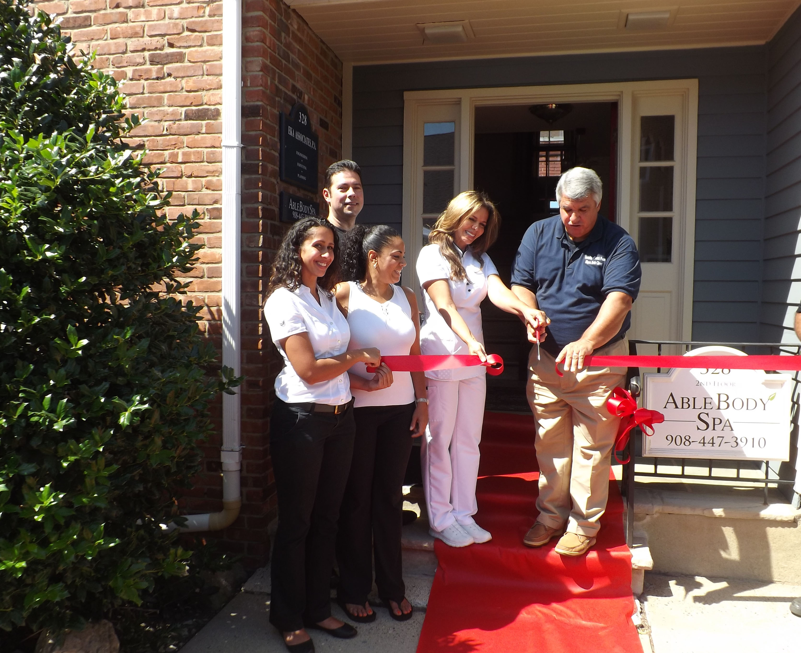 8978af36348d65a12d37_Able_spa_ribbon_cutting.jpg
