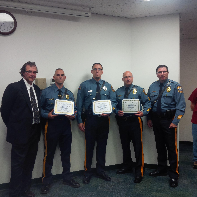 c214dcfb5748c290d156_elvidge_with_officers.jpg