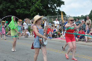 Hula hoops, vegetables, and banjos represented the Sparta Farmers Market's parade repetoire.