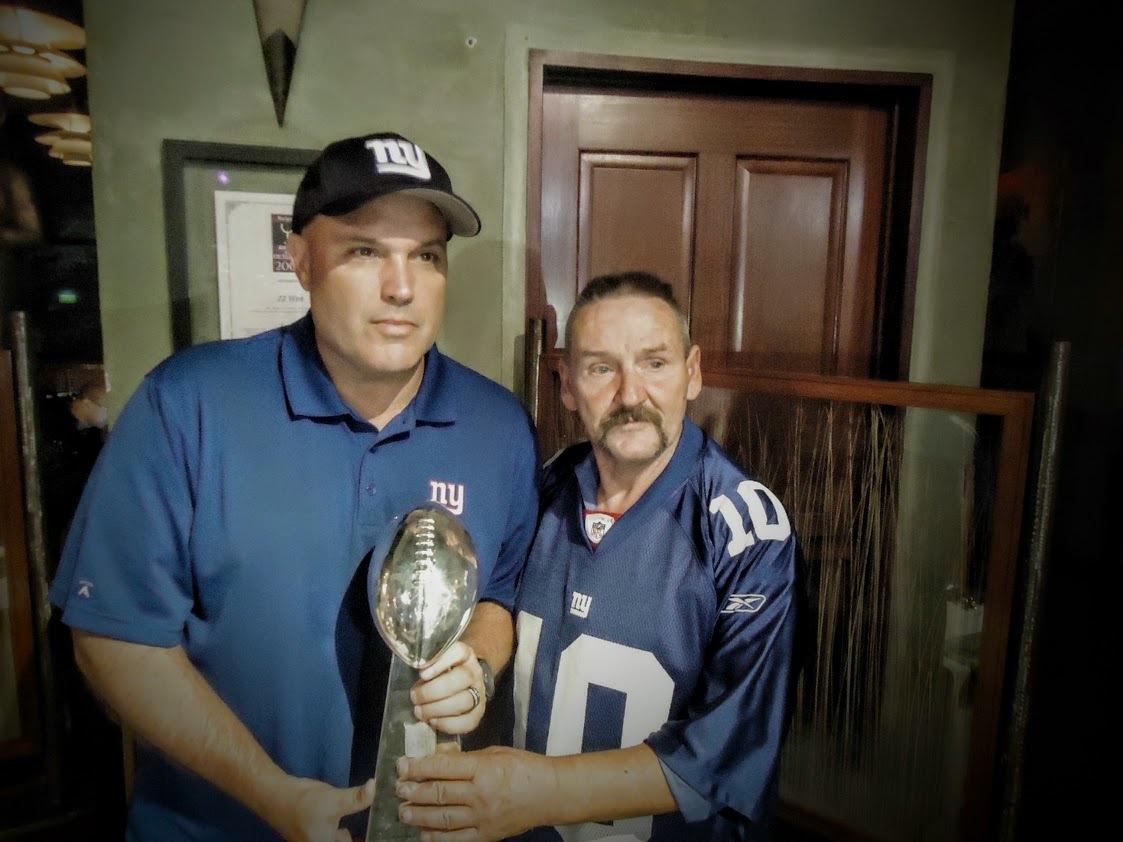 7c845b8b4b90472ed5d9_5305a87ebe3b9f2585f7_Clinton_Kelley_Rescue_story_Kelley__right__posing_for_photos_with_NY_Giants_Football_star_Sean_Landeta.JPG
