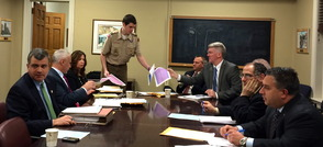 Alexander Kalos distributes plans for his Eagle Scout project proposal.