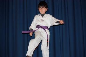 Benjamin Rudin, 1st grade, showing Taekwondo skills