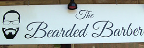 The instantly recognizable logo of The Bearded Barber