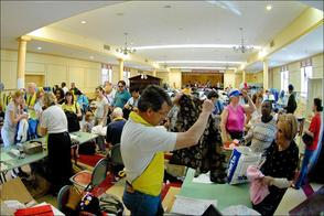 Ken Leiby of Short Hills assists a shopper at Community Church's Charity Rummage Sale.