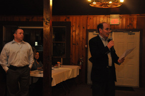 Glen Vetrano welcomes the guests, while Sheriff Mike Strada looks on.