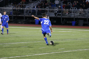 Peter Kost sends a ball downfield for Millburn.