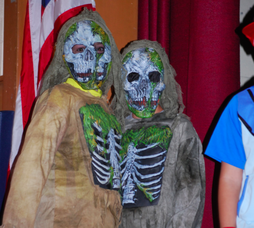 Two students dressed in scary costumes for Deerfield Elementary School's Halloween celebration.