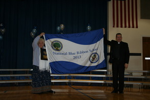 Principal Picillo and Monsignor Nydegger Present the Flag