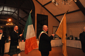 The procession of flag bearers, with the United States, New Jersey, and Irish Flags.