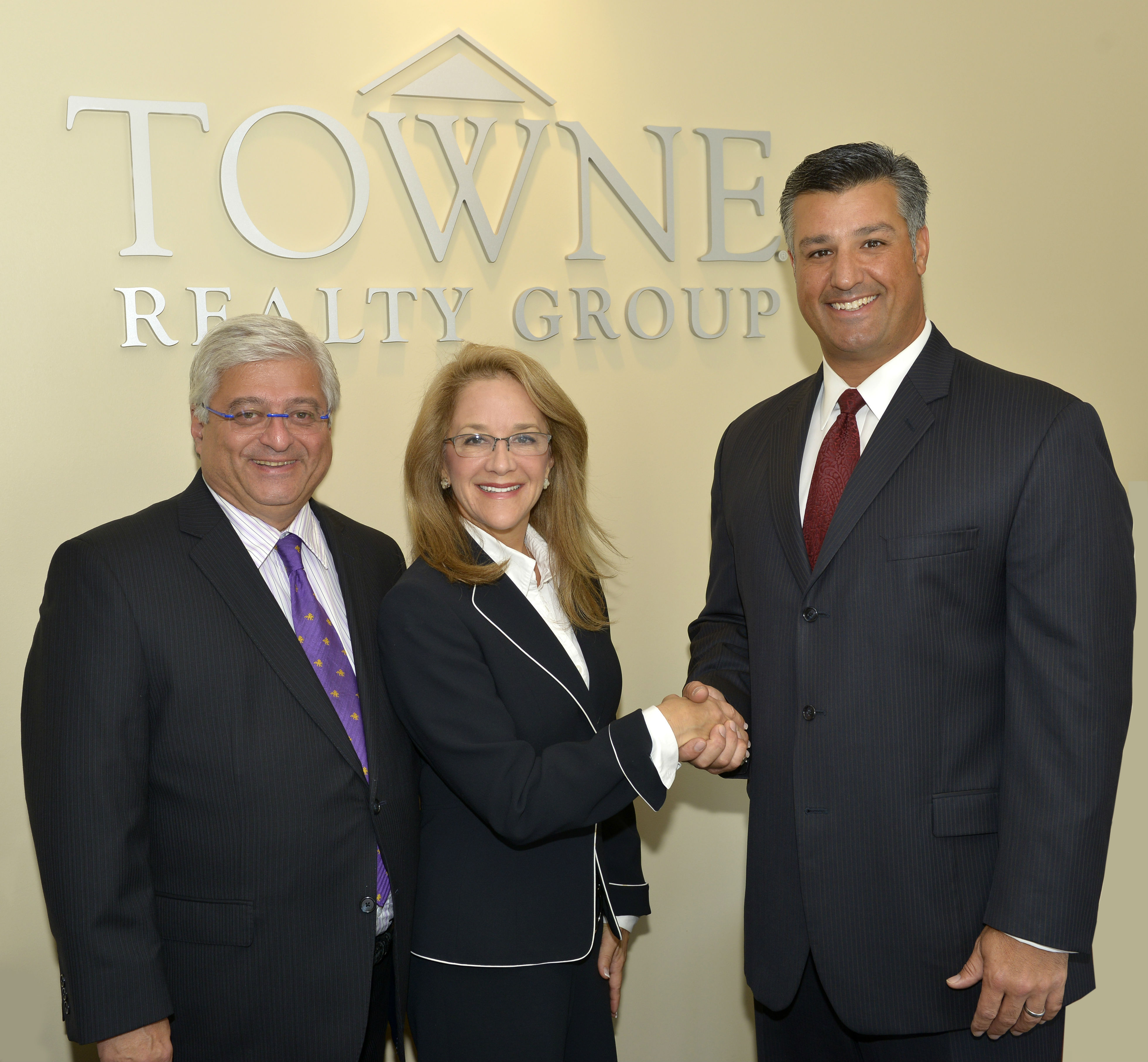 83d3129083a2f7150add_Dan_Karen_Tom_W_in_front_of_TOWNE_sign_2013.jpg