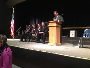 The candidates wait to take a turn at the podium.