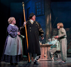 From left to right: Jessica Sheridan (Widow Corney), John Treacy Egan (Mr. Bumble) and Tyler Moran (Oliver).