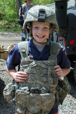 Trying on U.S. Army gear