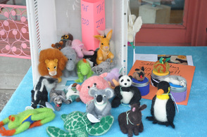 Small toy animals for sale during the sidewalk sale.