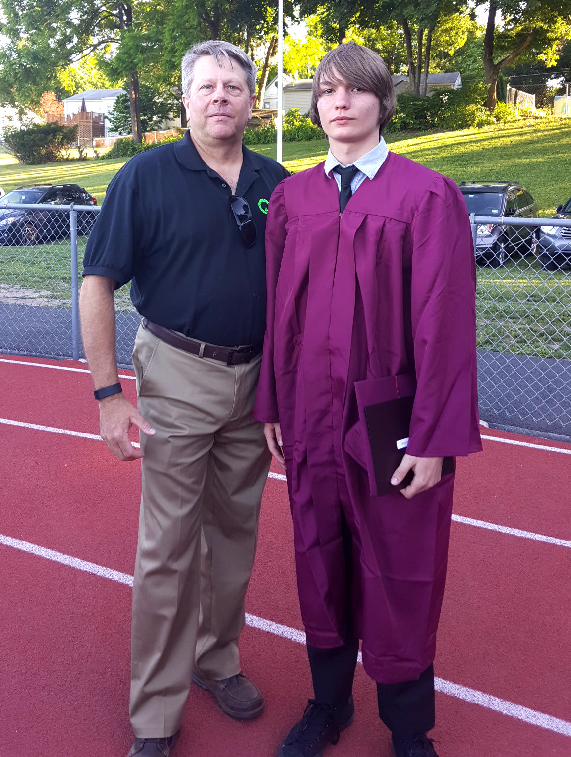 c2f40839fe64654fbdcb_Hofmann_and_Jake_graduation.jpg