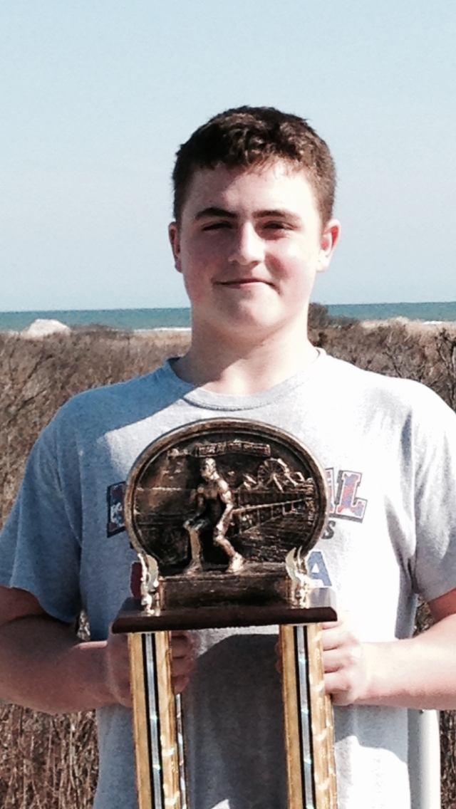 eb3aaf4153efbb8d325d_Luke_Niemeyer_Holds_His_War_at_the_Shore_1st_Place_Trophy_-_Picture.jpg