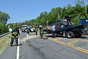 Sparta Fire Fighters help clear the highway following Tuesday's six vehicle crash