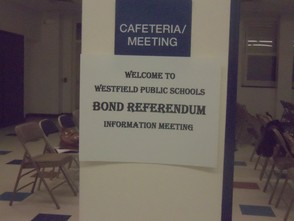 Posted sign for the meeting the cafeteria