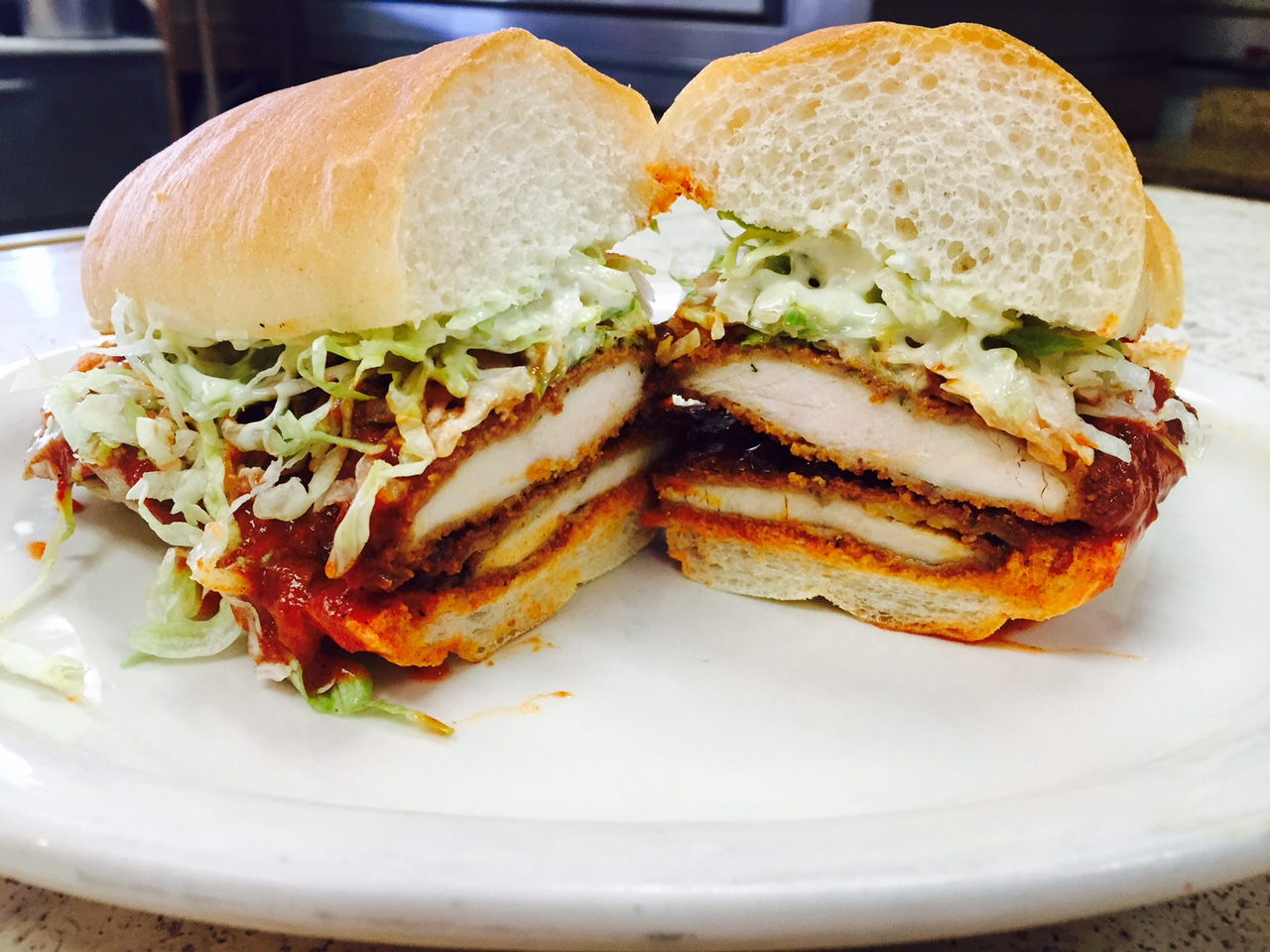d0a1adc4b517811fc817_Buff_chicken_sandwich.jpg