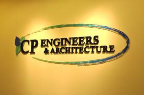 The company's logo on the wall, near the lobby area.