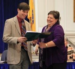 Jon Todd Muth takes his oath with Linda Alvarez