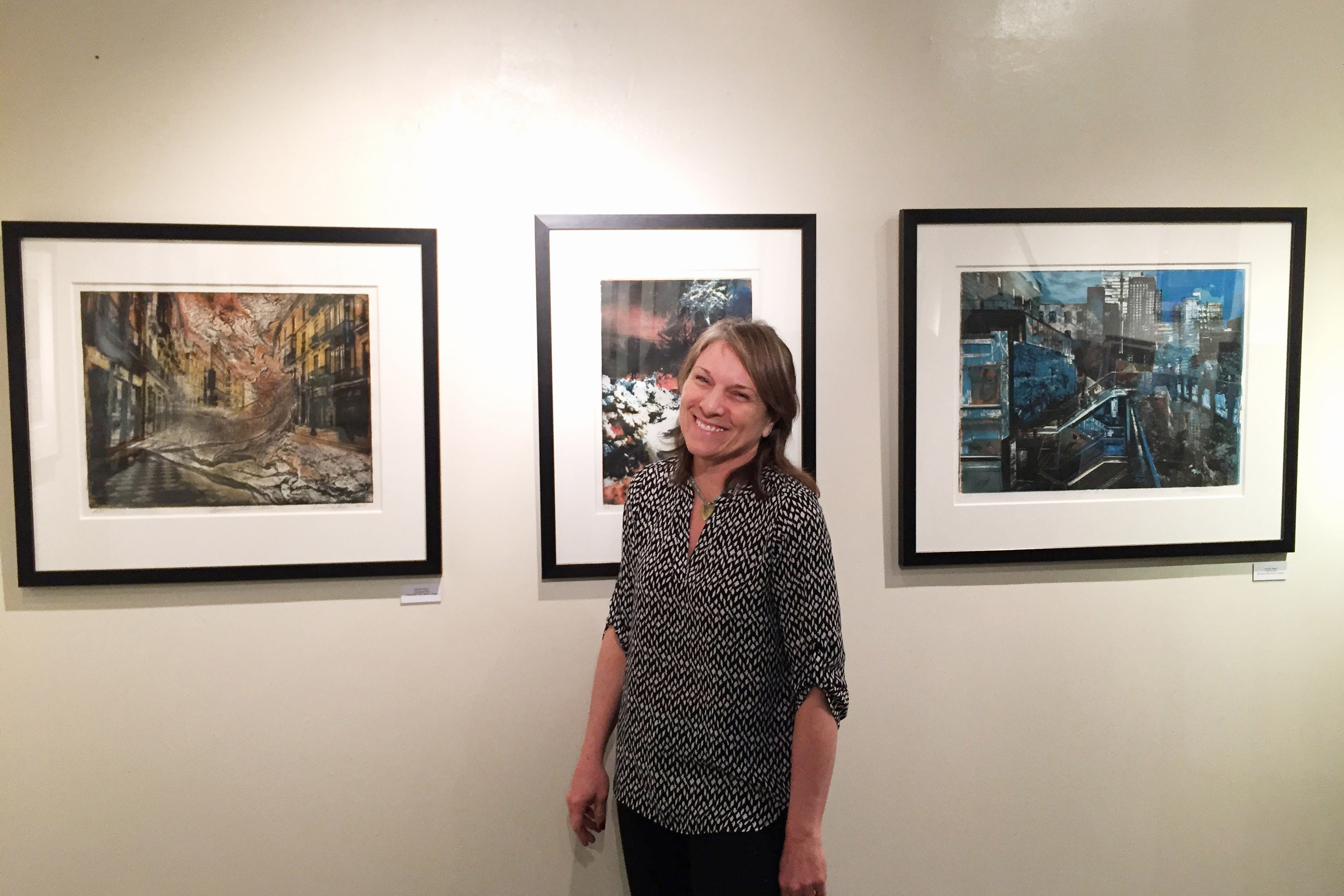 4bd87aa1fe21a8dd4818_Denise_Moser_hanging_her_art_in_the_show.jpg