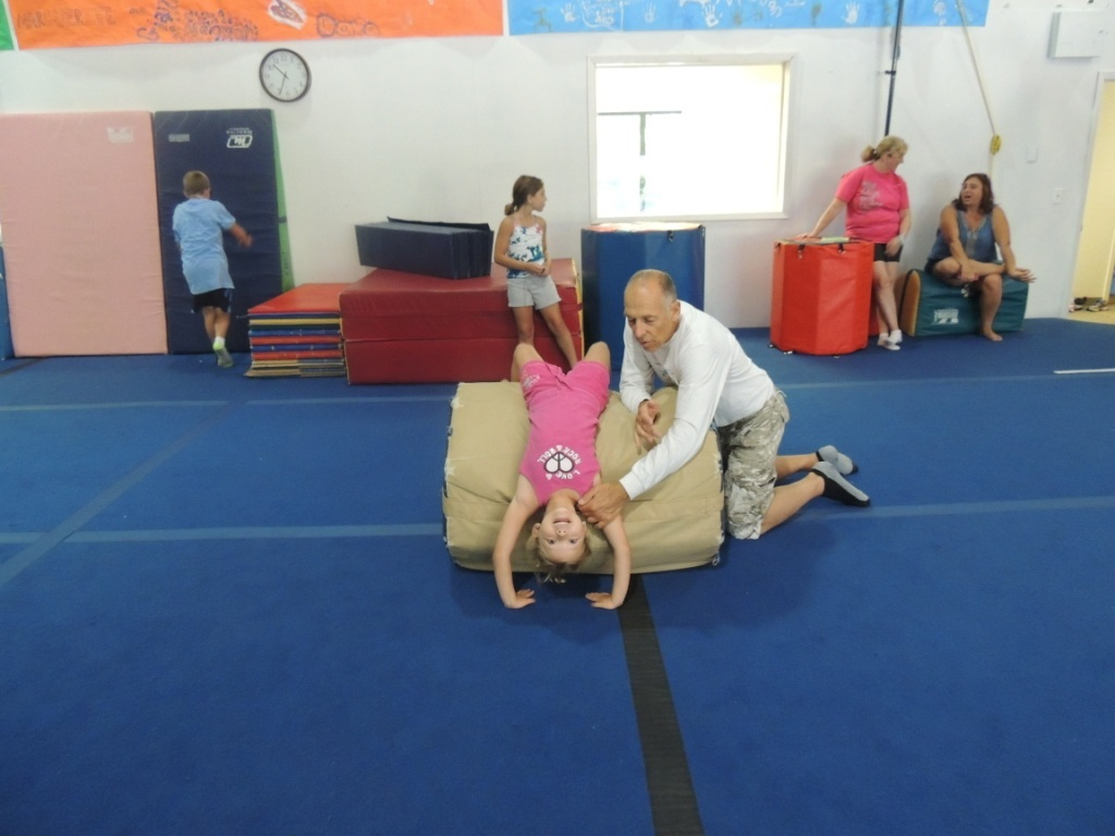 8fd46e783b302d86e699_Kallie_Young_of_Lafayette__with_her_grandfather__Coach_Bob_Schutz__learning_to_go_over_the_barrel..JPG