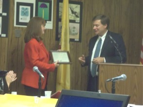 Richard Mattessich giving Dr. Dolan a plaque from the school district