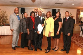 Members of the East Orange City Council present a resolution to Councilman William C. Holt