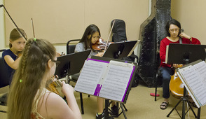 A candid photo of a string quartet from the 2013 Chamber Music Workshop