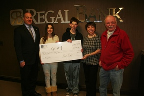 Regal Bank Presents Check to HCHY