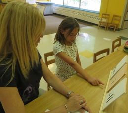 Wendy Maxwell providing individualized reading instruction.
