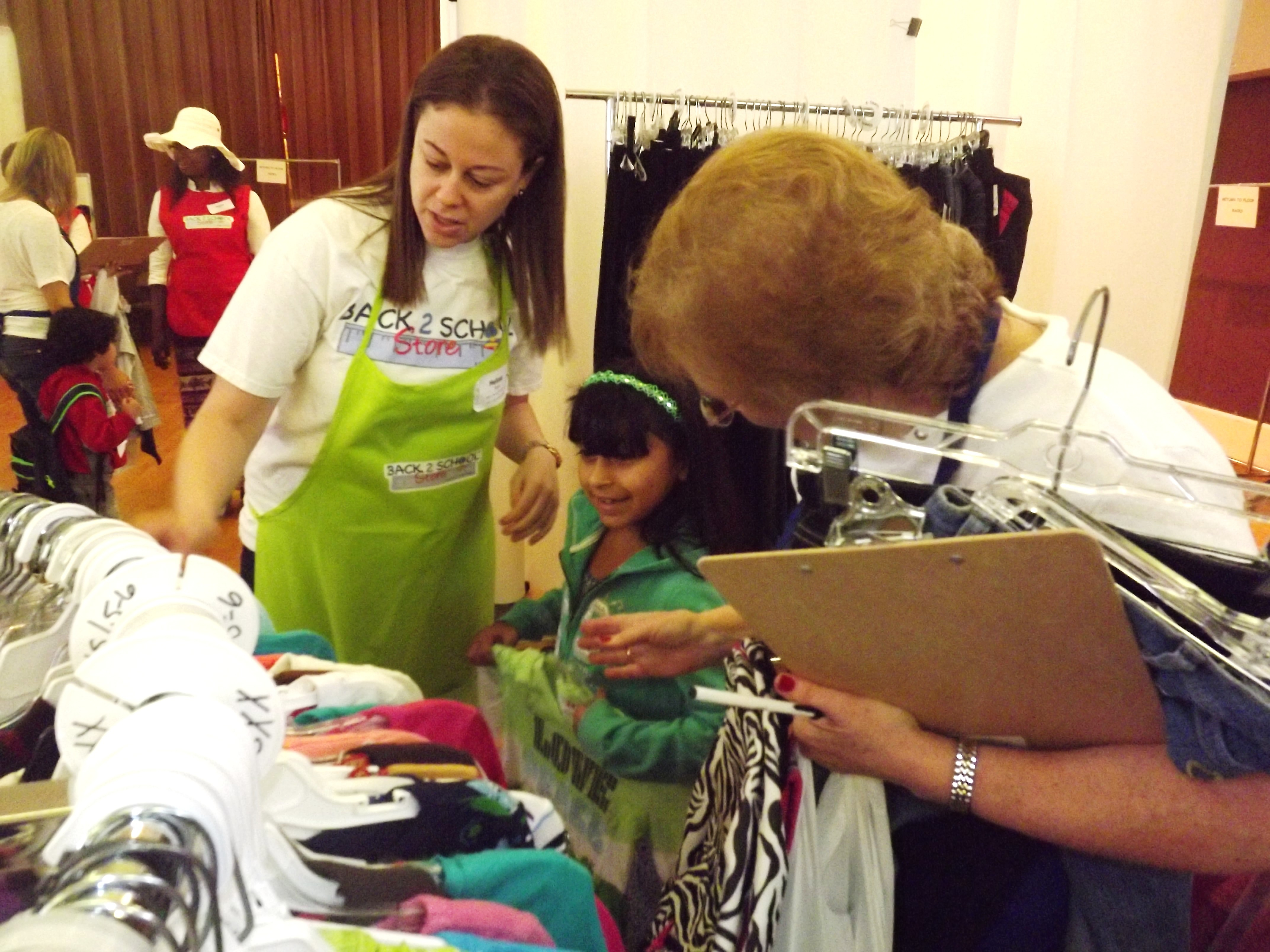 children welcomed at back school store in west orange department store assistant melissa sophia and personal shopper hedy look at outfits credits cynthiai cumming