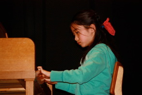 Melody Ma, 3rd grader, played Rondo in C Major (Beethoven).