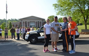 Special Olympics Torch Run State Coordinator Cesar Morales and Cpl Susan Parks