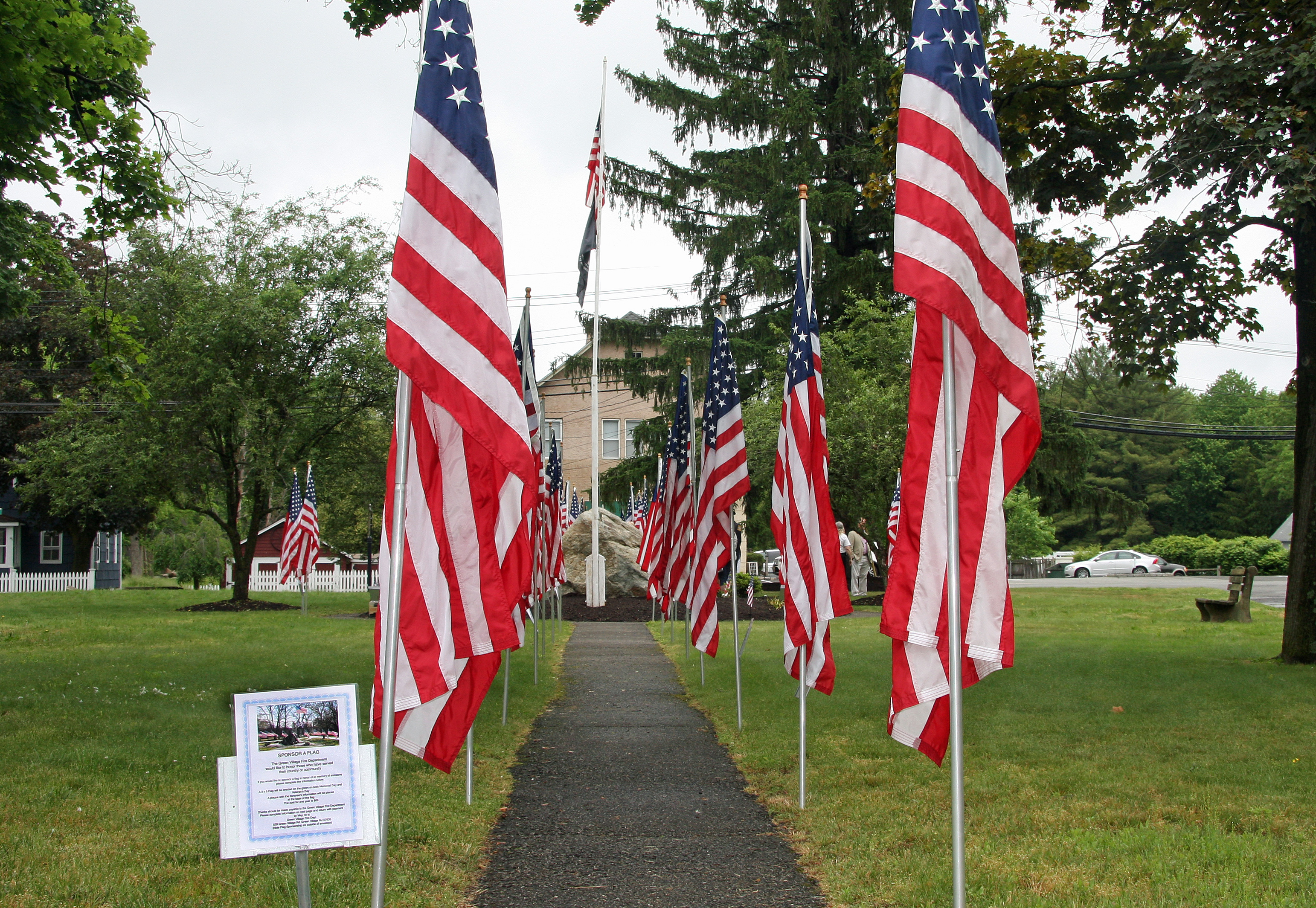 0b602d966febdba6feae_1089a4b351902001fbcf_Green_Village_Green__Memorial_Flags_-_Photo_by_Tom__Salvas.jpg