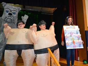 Second graders Justin Horowitz and Zachary Lipton celebrate Halloween with Ms. Donna Tucci and the Deerfield Bulldog.