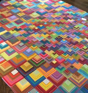 Modern and traditional fabric art and quilts featured.
