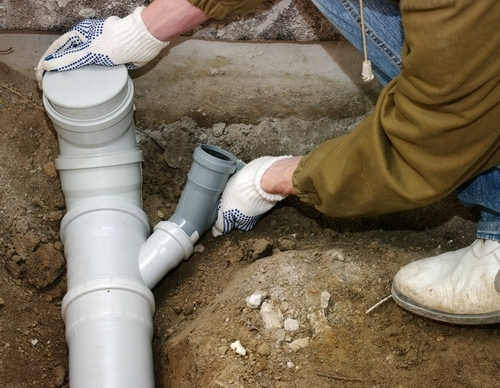 How to stop sewer backup problems before you re knee deep for Sewer backup smell in house