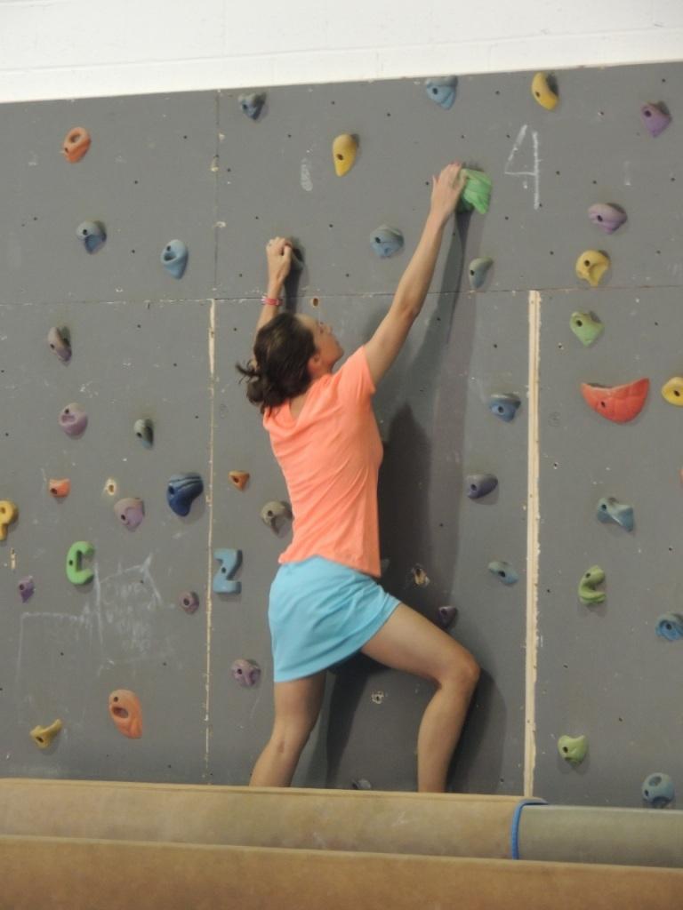 81b9d57823fb0f0bb169_Lauren_Packard_playing_during_open_gym__climbing_on_the_rock_wall..JPG