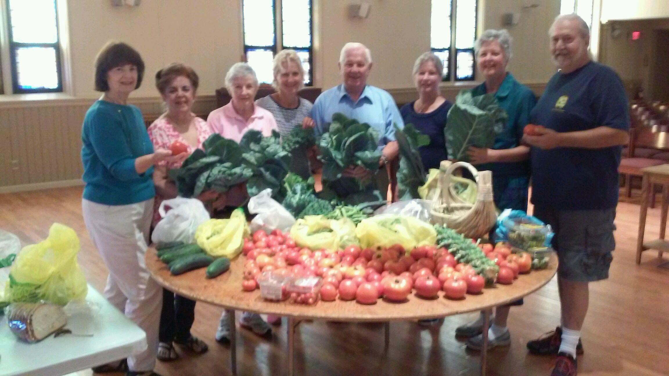 beff5fb4c49b8434e59a_Summit_Community_Garden_Bounty_for_St_Teresa_s.jpg