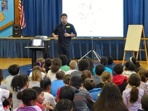 Top_story_a2ff647acb81cd07ef28_fourth_and_fifth_grade_gregory_students_listen_to_author_george_o_connor