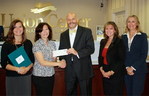 Union Center National Bank presents check to Madison Education Foundation